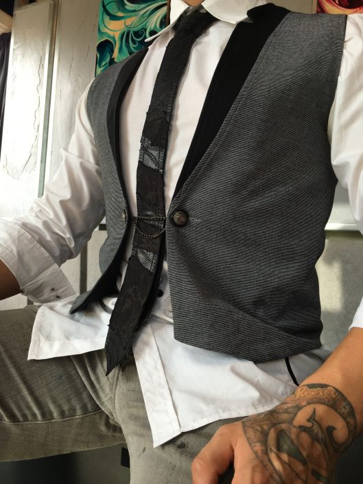 Grey Vest with Chain Button and Black Multimedia Tie by Joanna Coblentz