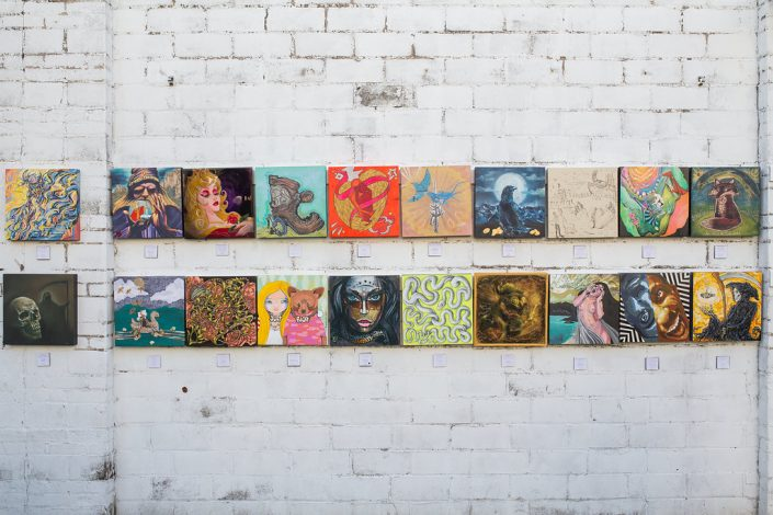 Paintings Hanging on the Wall at Black Amethyst Tattoo Galelry Art Show