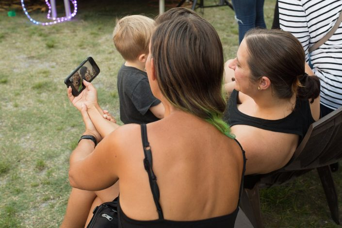 Two Woman Taking a Selfie at Black Amethyst Tattoo Gallery Art Show