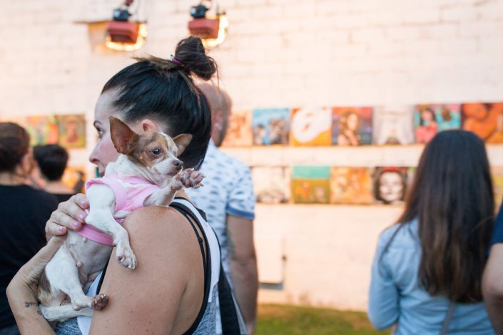 Woman Carrying Her Chihuahua at Black Amethyst Tattoo Gallery Art Show