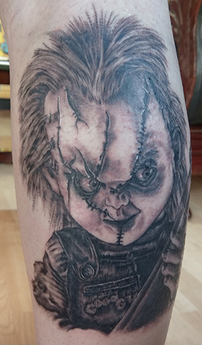 St Pete Tattoo Black and Grey Chucky Front by Amanda Banx