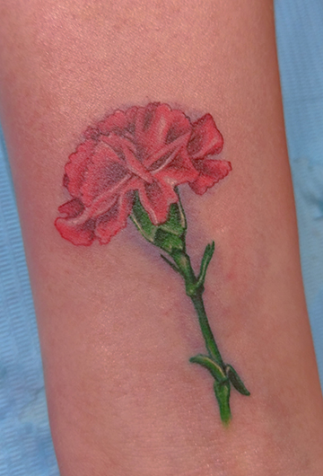 St Pete Tattoo Green and Red Flower by Amanda Banx