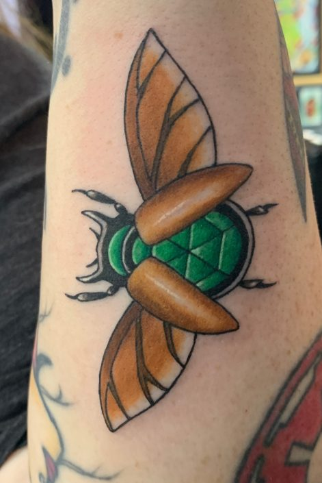 Flying beetle Tattoo by Shannon Haines